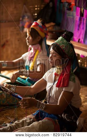 Two Kayan Lahwi Girls are Weaving.