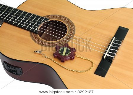 Acoustic guitar and a tuning fork