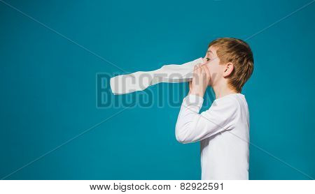 Boy In White Clothes Blowing His Nose