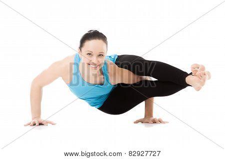 Yogi Female In Yoga Asana Astavakrasana, Eight-angle Pose