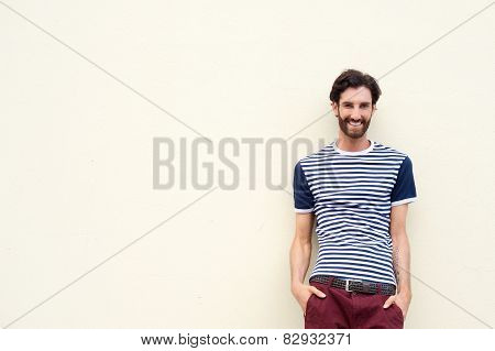 Portrait of a confident young man smiling on white background poster