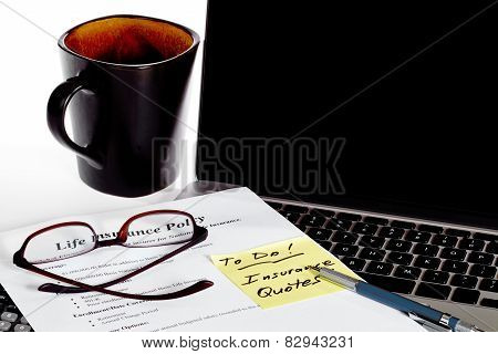 Life Insurance Policy Decisions With Coffee And Laptop