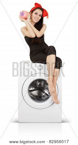 Cute Girl With Piggy Bank  on a Washing machine