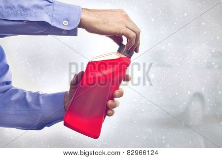 Man With A Bottle Of Antifreeze
