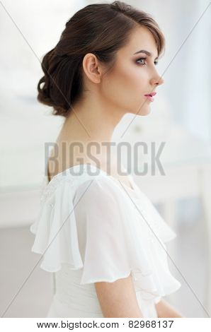 Portrait of beautiful woman in girlish bedroom