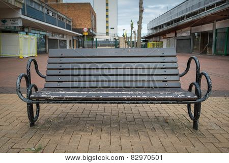 Wooden Bench In An Abandoned High Street