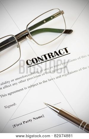 Contract And Pen With Glasses