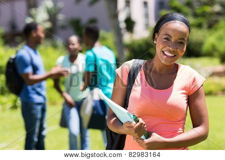 happy young African American college girl holding books
