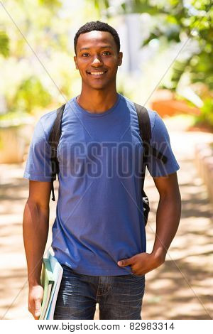 good looking male african college student walking on campus poster