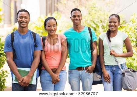 group of happy african college students standing together on campus
