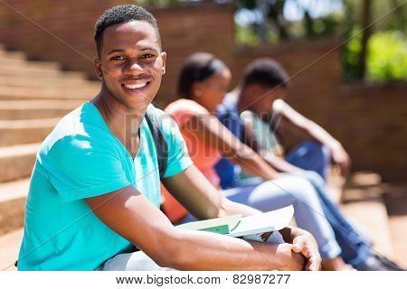 happy young male african college student on campus