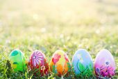Handmade Easter eggs on grass. Floral, colorful spring patterns and designs. Traditional, artistic and unique. poster