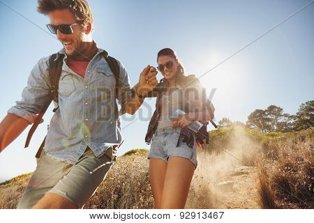 Happy Young Couple Enjoying Their Hiking Trip