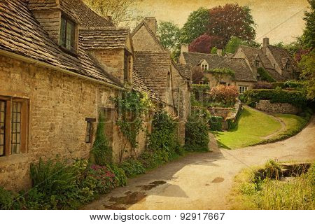 Traditional Cotswold cottages after the rain.
