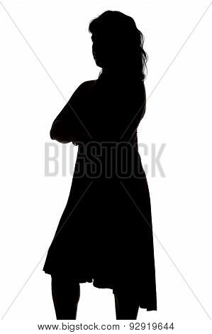 Silhouette of woman with arms crossed