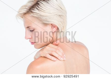 Beautiful woman with neck pain on white background