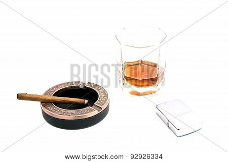 Lighter, Cigarillo In Ashtray And Alcohol