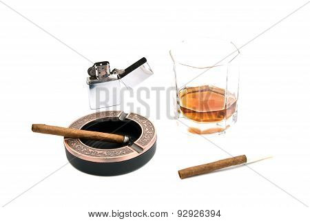Two Cigarillos, Ashtray, Lighter And Whiskey