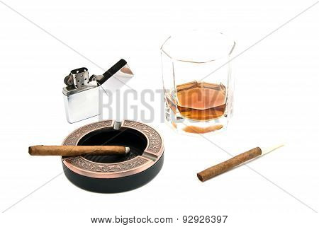 Two Cigarillos, Ashtray, Lighter And Glass Of Whiskey
