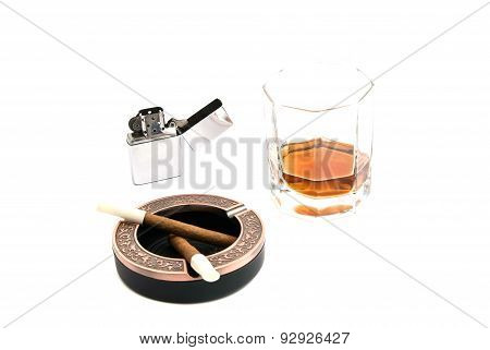 Two Cigarillos In Ashtray And Glass Of Whiskey