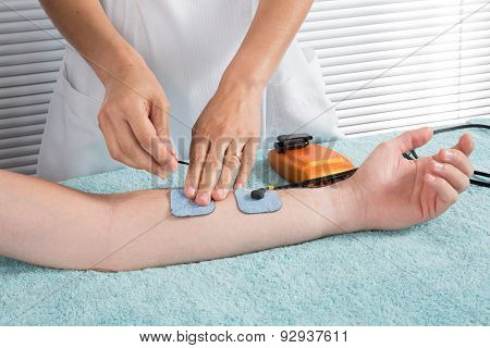 Man Is Doing Massage Of Electrostimulator Medical Procedure.