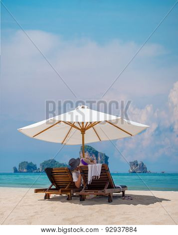 Mature couple relaxing on the beach in Thailand