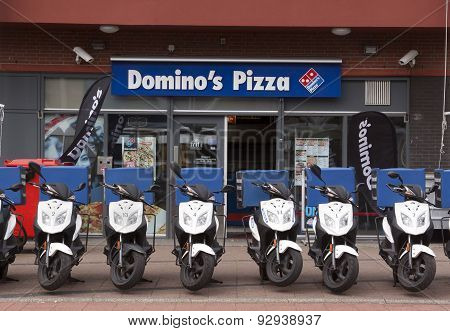 Domino's Pizza Store In The Hague With Scooters In The Front