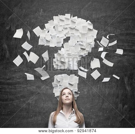 Business Woman Is Thinking About The Question Mark Which Consists Of The Contract Pages. Dark Backgr