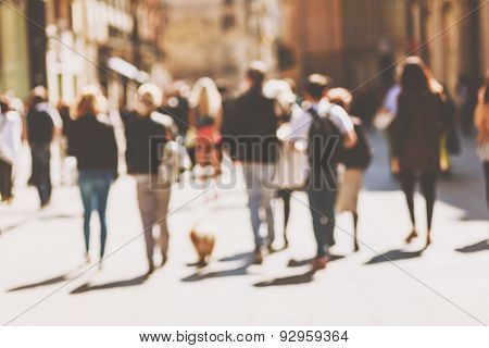 Blurred crowd of walking people in the city