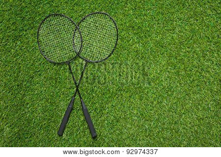 Badminton rackets lying on the grass