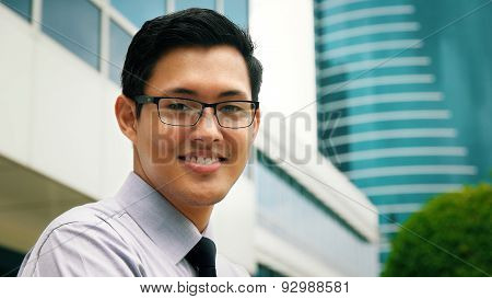 Portrait Chinese Businessman Smiling Outside Office Skyscraper