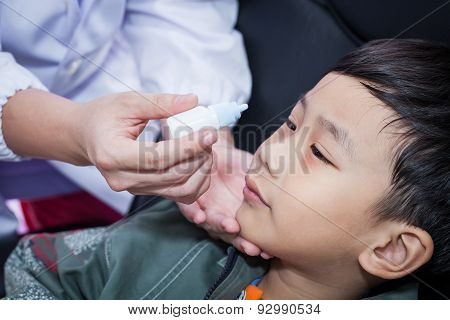 Doctor Pouring Eye Drops In Eye Patient