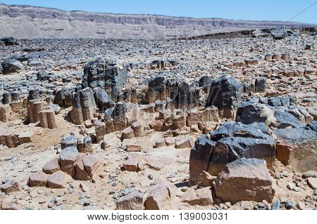 National geological park HaMakhtesh HaRamon - Ramon Crater is the Largest crater- geological erosion land form in Israel . Solidified igneous rocks .