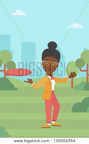 An african-american woman playing flying disc in the park. Young woman throwing a flying disc. Sportswoman catching flying disc outdoors. Vector flat design illustration. Vertical layout.