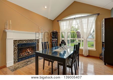 American Dining Room Interior With Black Table Set And Fireplace.