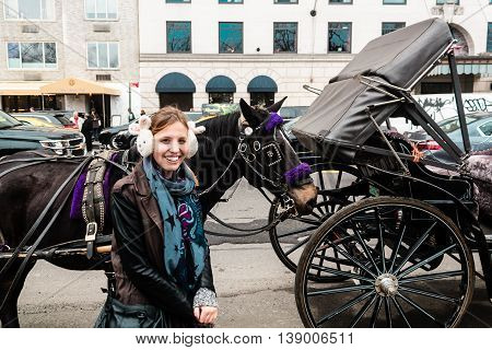 Girl Inf Front Of Horse And Carriage Near Central Park In Manhattan, New York Ciry