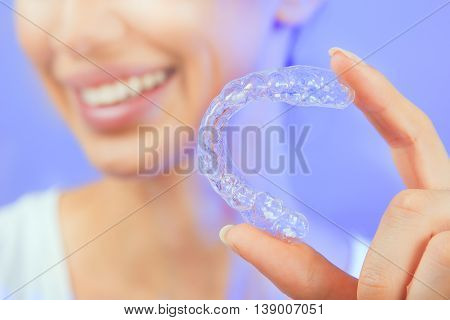 Beautiful Smiling Girl with Tooth Tray (hands Holding Individual Tooth Tray) Methods of Teeth Teeth Whitening and Correction Close-up (blue filter effect)