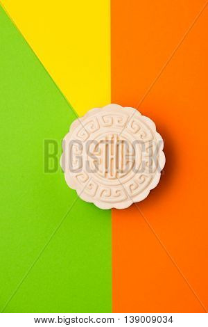 Snow skin mooncake on coloful background. Top view.