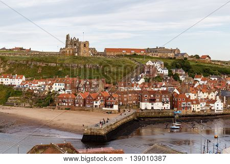 WHITBY ENGLAND - JULY 16: The ruins of Whitby Abbey with the harbour in the foreground. In Whitby North Yorkshire England. On 16th July 2016.