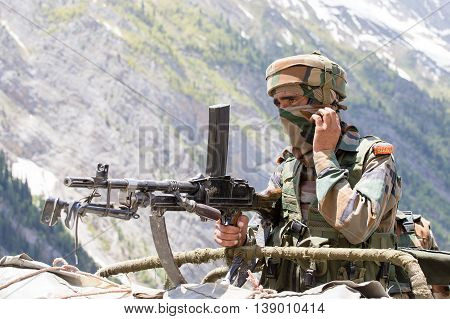 JAMMU AND KASHMIR INDIA - JUNE 12 2015 : Unknown Indian frontier guard. Indian Army checkpoint in Kashmir Himalayas. Kashmir became dangerous again