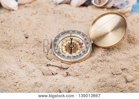 Vintage Compass on the sand. Studio shot