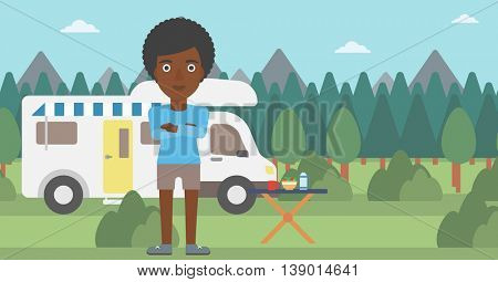 An african-american woman standing in front of motor home. Woman with arms crossed enjoying vacation in camper van. Woman travelling by camper van. Vector flat design illustration. Horizontal layout.