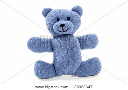 Blue teddy bear isolated over white background