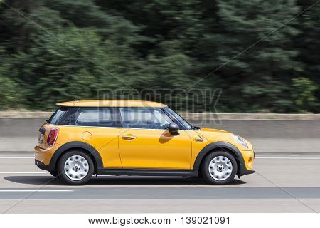 FRANKFURT GERMANY - JULY 12 2016: Third Generation Mini One Hatch on the highway in Germany