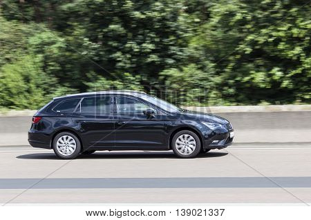 FRANKFURT GERMANY - JULY 12 2016: Seat Leon ST Estate family car on the highway in Germany