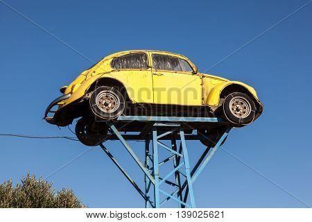 ALMERIA SPAIN - OCT 17 2015: Old yellow Volkswagen Beetle used as a Junkyard sign in Spain