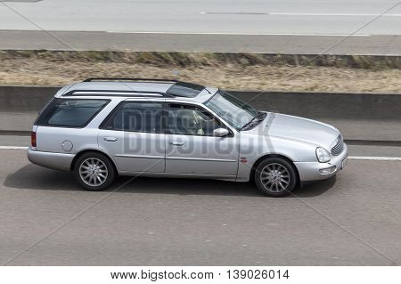 FRANKFURT GERMANY - JULY 12 2016: Old Ford Scorpio Estate driving on the highway in Germany