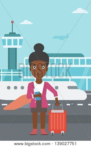An african-american woman with suitcase holding a passport with ticket at the airport. Vector flat design illustration. Vertical layout.