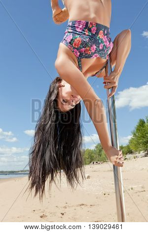 Smiling Girl On Pylon For Dance Upside Down