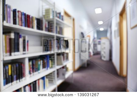 Modern library. Corridor between bookshelves